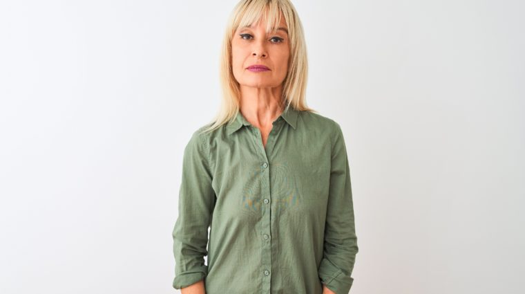 Photo of woman in green blouse with serious expression